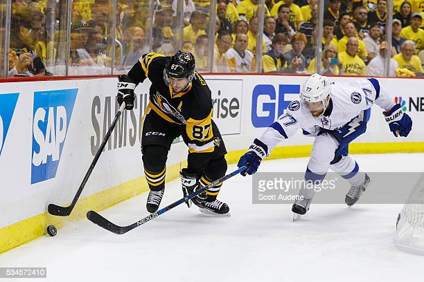 Victor Hedman of the Tampa Bay Lightning reaches for the puck against Sidney Crosby of the Pittsburgh Penguins during the second period of Game Seven...