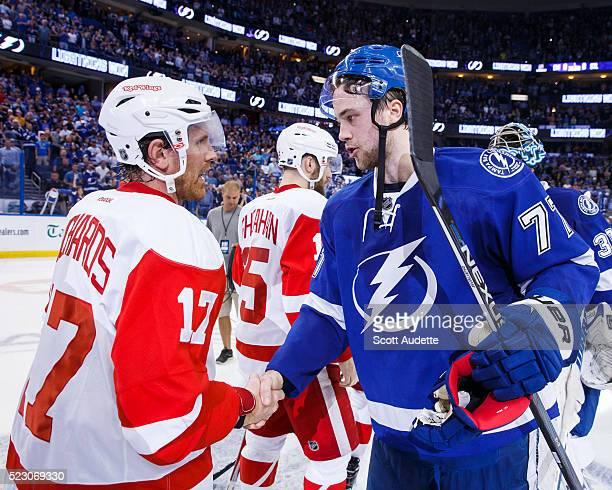 Victor Hedman of the Tampa Bay Lightning shakes the hand of Brad Richards of the Detroit Red Wings after the series win in Game Five of the Eastern...