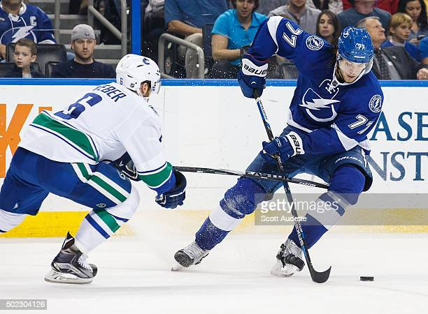 Victor Hedman of the Tampa Bay Lightning skates against Yannick Weber of the Vancouver Canucks during the second period at the Amalie Arena on...