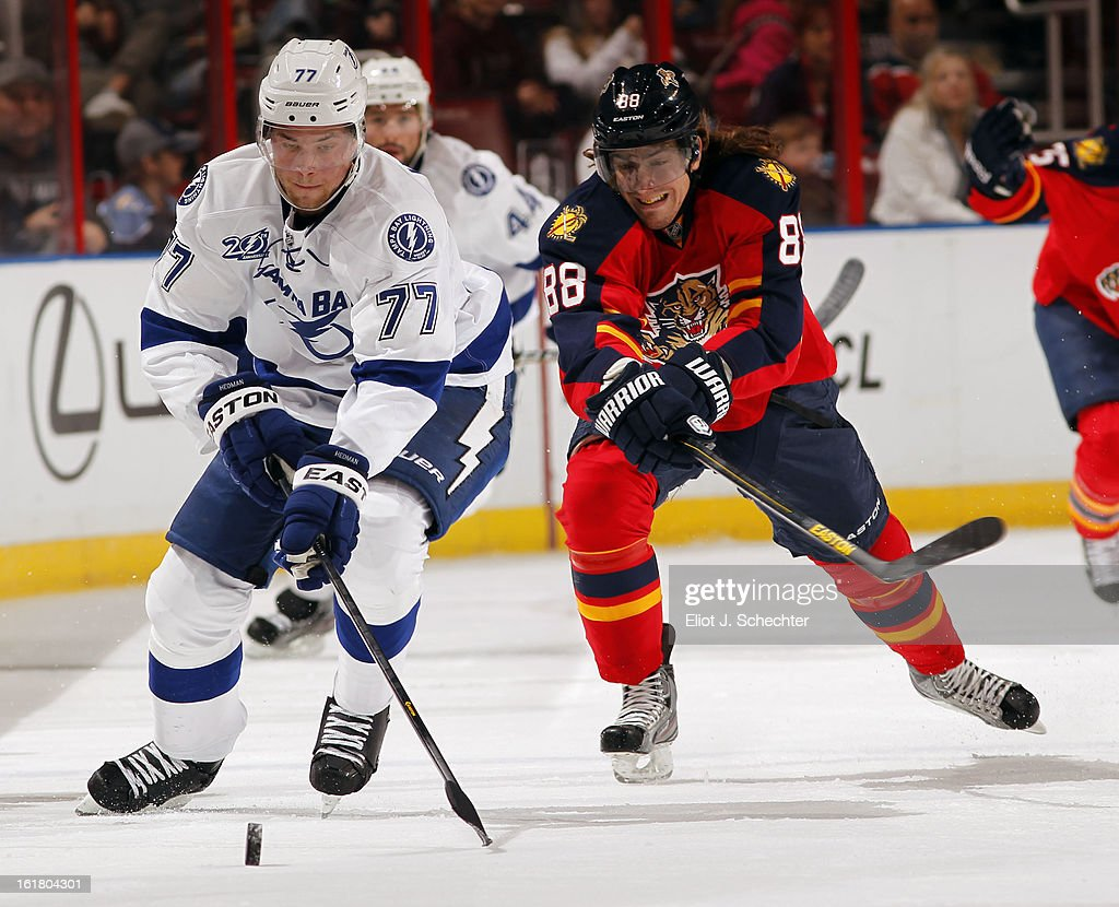 Victor Hedman #77 of the Tampa Bay Lightning skates with the puck against Peter Mueller #88 of the Florida Panthers at the BB&T Center on February 16, 2013 in Sunrise, Florida.