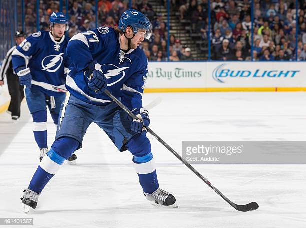 Victor Hedman of the Tampa Bay Lightning skates with the puck against the New York Rangers at the Tampa Bay Times Forum on December 29 2013 in Tampa...