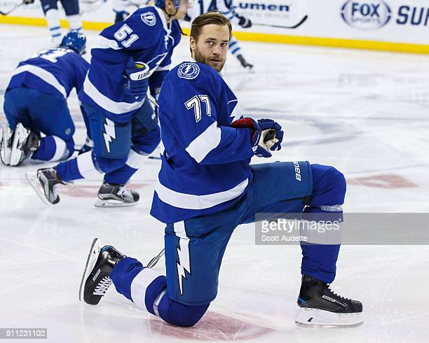 Victor Hedman of the Tampa Bay Lightning stretches during the pregame warmups against the Winnipeg Jets at the Amalie Arena on February 18 2016 in...