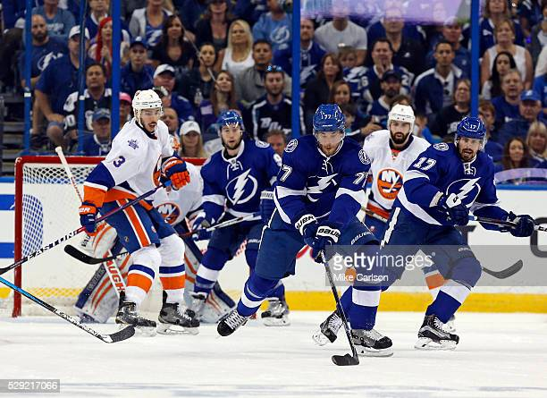 Victor Hedman of the Tampa Bay Lightning turns to score against the New York Islanders during the first period of Game Five of the Eastern Conference...