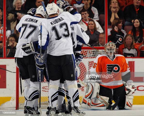 Victor Hedman Pavel Kubina and Nate Thompson of the Tampa Bay Lightning celebrate a first period goal on November 18 2010 at the Wells Fargo Center...