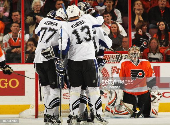 Victor Hedman Pavel Kubina and Nate Thompson of the Tampa Bay Lightning all celebrate a first period goal against a fallen Sergei Bobrovsky of the...
