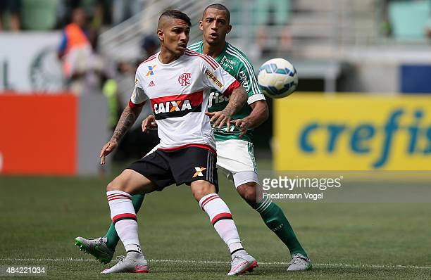 Victor Hugo of Palmeiras fights for the ball with Guerrero of Flamengo during the match between Palmeiras and Flamengo for the Brazilian Series A...