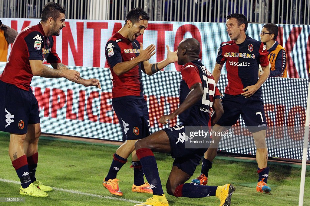 Victor Ibarbo of Cagliari celebrates with teammates after the goal 10 during the Serie A match between Cagliari Calcio and AC Milan at Stadio...