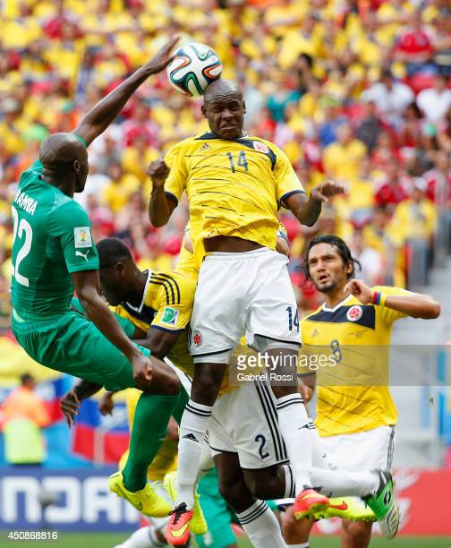 Victor Ibarbo of Colombia goes up for a header against Sol Bamba of the Ivory Coast during the 2014 FIFA World Cup Brazil Group C match between...