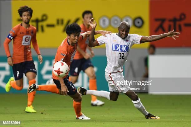 Victor Ibarbo of Sagan Tosu and Hiroyuki Komoto of Omiya Ardija compete for the ball during the JLeague J1 match between Sagan Tosu and Omiya Ardija...