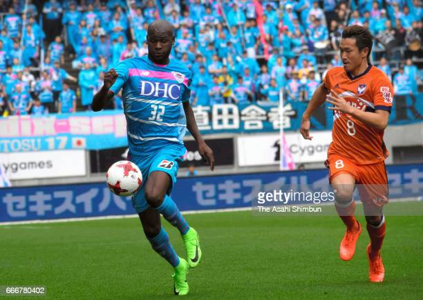 Victor Ibarbo of Sagan Tosu and kei Koizumi of Albirex Niigata compete for the ball during the JLeague J1 match between Sagan Tosu and Albirex...