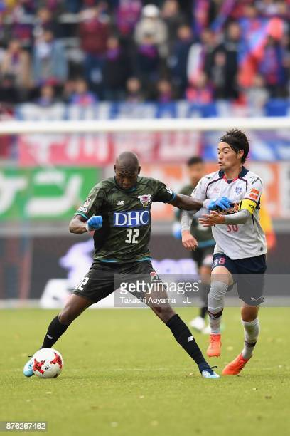 Victor Ibarbo of Sagan Tosu and Keigo Higashi of FC Tokyo compete for the ball during the JLeague J1 match between Sagan Tosu and FC Tokyo at Best...