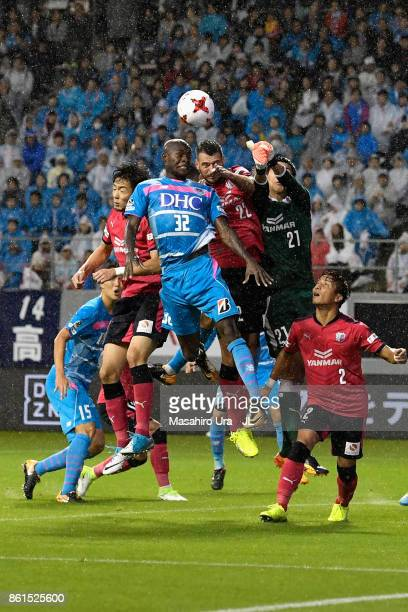 Victor Ibarbo of Sagan Tosu and Kim Jin Hyeon of Cerezo Osaka compete for the ball during the JLeague J1 match between Sagan Tosu and Cerezo Osaka at...