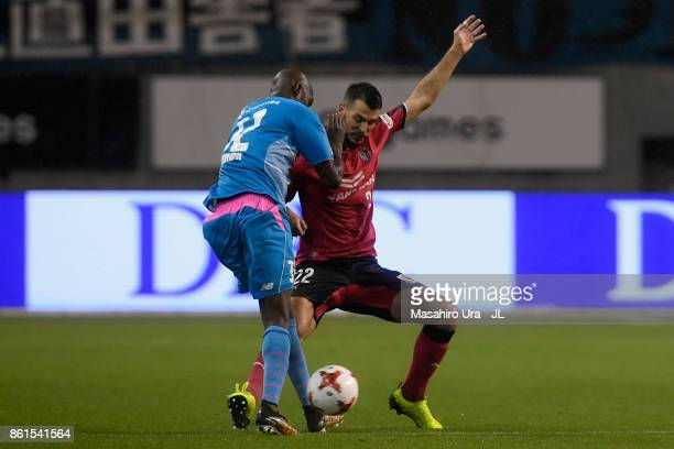 Victor Ibarbo of Sagan Tosu and Matej Jonjic of Cerezo Osaka compete for the ball during the JLeague J1 match between Sagan Tosu and Cerezo Osaka at...