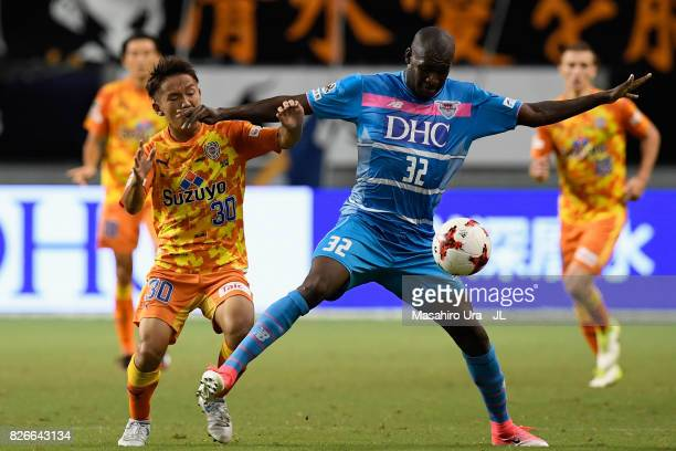 Victor Ibarbo of Sagan Tosu and Shota Kaneko of Shimizu SPulse compete for the ball during the JLeague J1 match between Sagan Tosu and Shimizu SPulse...