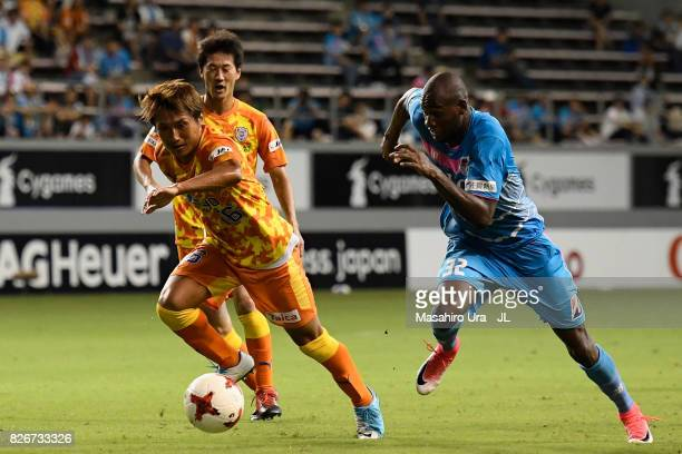 Victor Ibarbo of Sagan Tosu and Taisuke Muramatsu of Shimizu SPulse compete for the ball during the JLeague J1 match between Sagan Tosu and Shimizu...