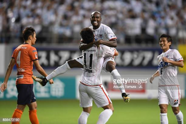 Victor Ibarbo of Sagan Tosu celebrates scoring his side's second goal with his team mate Yohei Toyoda during the JLeague J1 match between Sagan Tosu...