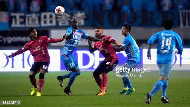 Victor Ibarbo of Sagan Tosu competes for the ball against Riku Matsuda and Souza of Cerezo Osaka during the JLeague J1 match between Sagan Tosu and...