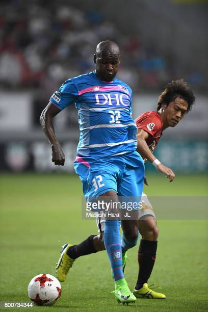 Victor Ibarbo of Sagan Tosu controls the ball under pressure of Yoshiaki Komai of Urawa Red Diamonds during the JLeague J1 match between Sagan Tosu...