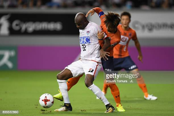 Victor Ibarbo of Sagan Tosu controls the ball under pressure of Kosuke Kikuchi of Omiya Ardija during the JLeague J1 match between Sagan Tosu and...