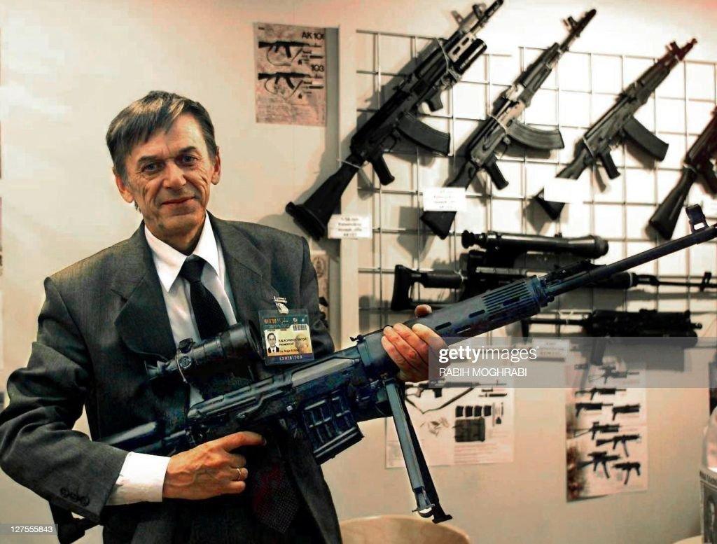 Victor Kalashnikov the son of Russian Mikhail Kalashnikov the inventor of the famous assault rifle shows off a model of his own pistol machinegun the...