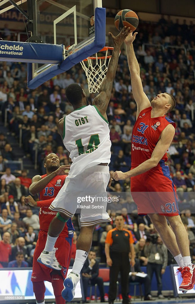 Victor Khryapa #31 of CSKA Moscow blocks James Gist #14 of Panathinaikos Athens during the 20142015 Turkish Airlines Euroleague Basketball Play Off...