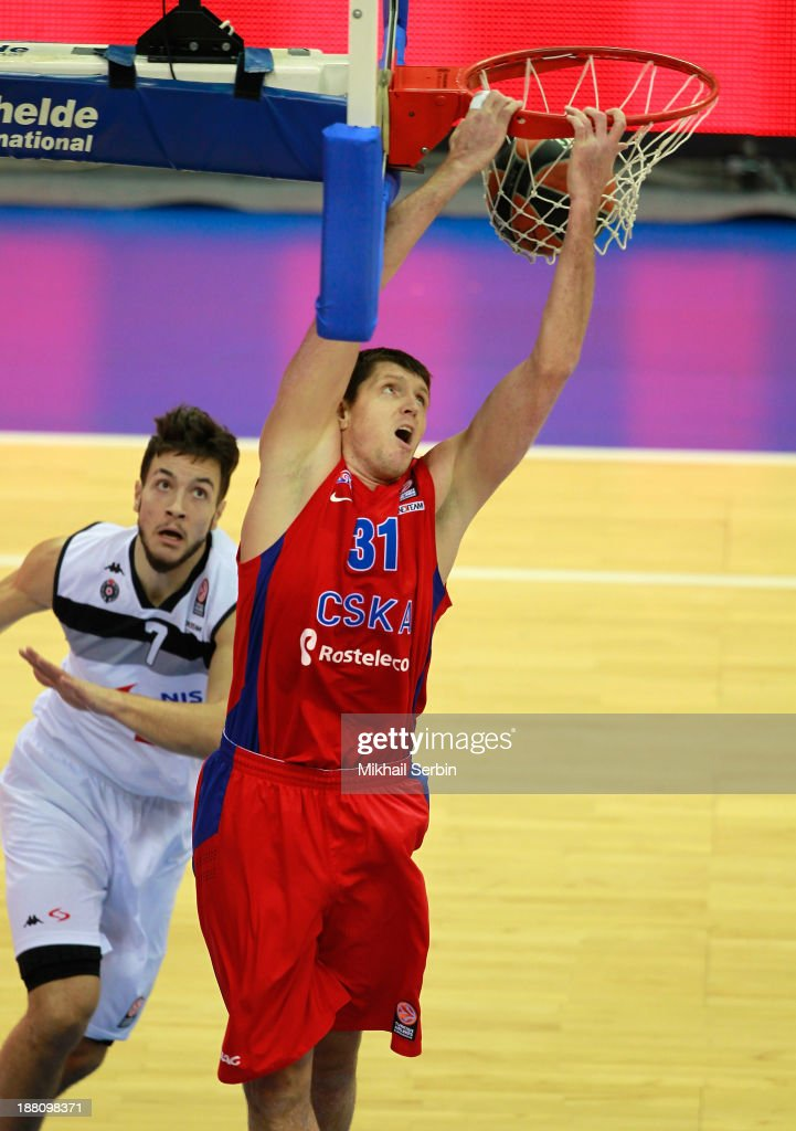 Victor Khryapa #31 of CSKA Moscow competes with Joffrey Lauvergne #7 of Partizan NIS Belgrade during the 20132014 Turkish Airlines Euroleague Regular...