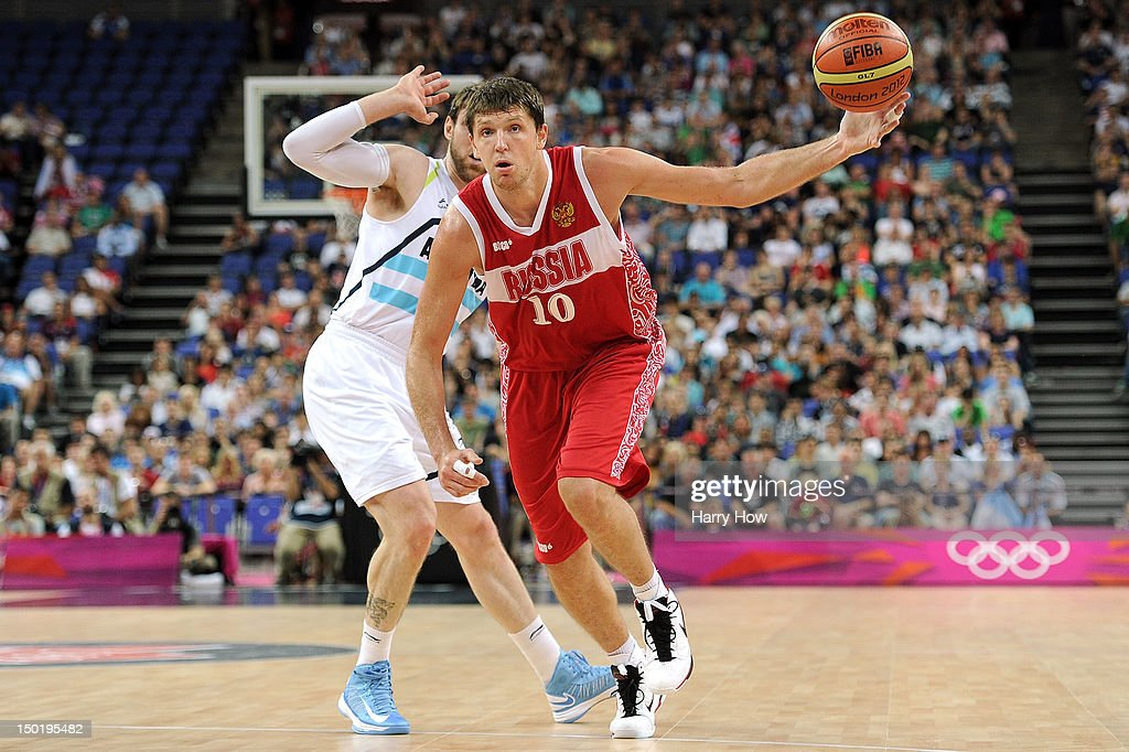 Victor Khryapa of Russia beats Andres Nocioni of Argentina during the Men's Basketball bronze medal game between Russia and Argentina on Day 16 of...