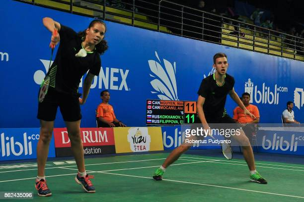 Victor Kokhanov and Elena Filippova of Russia compete against Nicolas Nguyen and Alexandra Mocanu of Canada during Mixed Double qualification round...