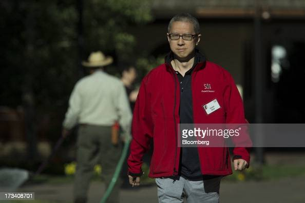 Victor Koo chairman and chief executive officer of Youku Tudou Inc walks to a morning session at the Allen Co Media and Technology Conference in Sun...