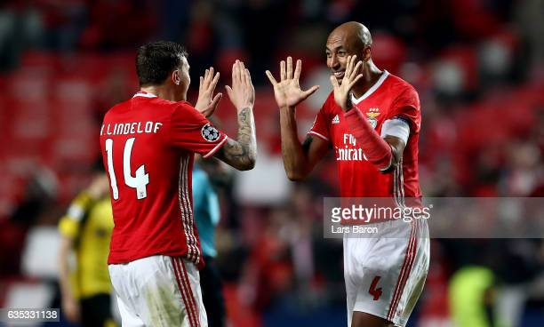 Victor Lindeloef of Benfica celebrate with team mate Luisao after winning the UEFA Champions League Round of 16 first leg match between SL Benfica...