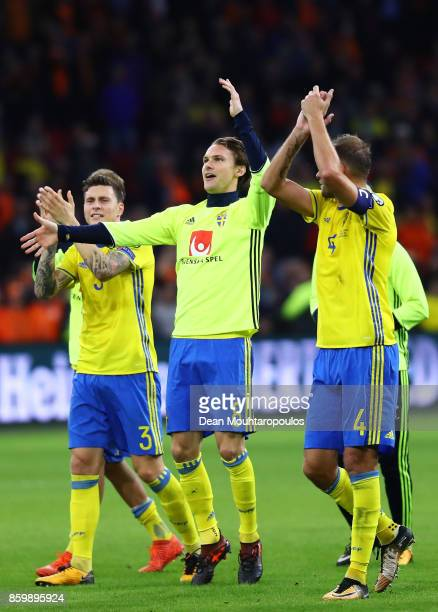 Victor Lindelof Albin Ekdal and Andreas Granqvist of Sweden celebrate after the FIFA 2018 World Cup Qualifier between Netherlands and Sweden at the...