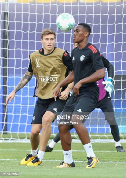 Victor Lindelof and Anthony Martial of Manchester United in action during a training session ahead of the UEFA Super Cup match between Manchester...