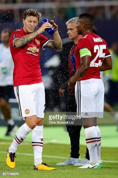 Victor Lindelof and Antonio Valencia both of Manchester United during a cooling break during the UEFA Super Cup match between Real Madrid and...