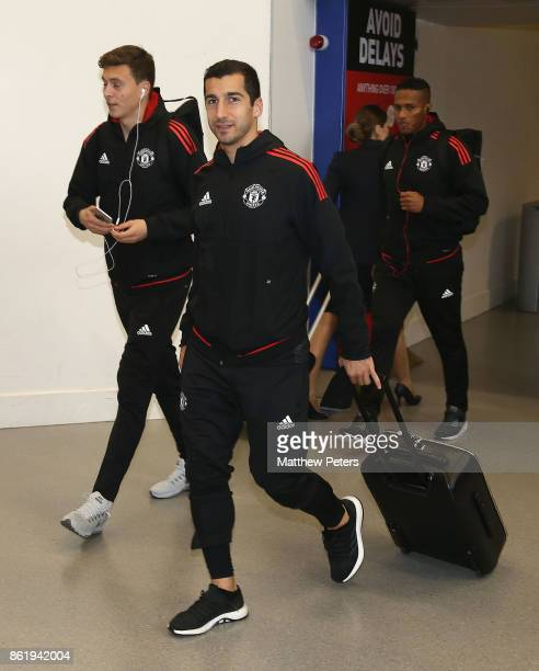Victor Lindelof and Henrikh Mkhitaryan of Manchester United check in ahead of their flight to Lisbon for the UEFA Champions League match against...