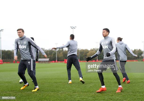 Victor Lindelof and Jesse Lingard of Manchester United in action during a first team training session at Aon Training Complex on October 26 2017 in...