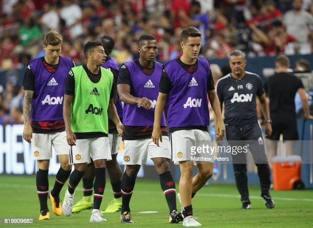 Victor Lindelof Jesse Lingard and Antonio Valencia and Ander Herrera of Manchester United warm up ahead of the preseason friendly International...
