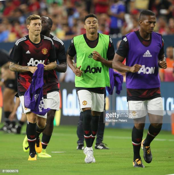 Victor Lindelof Jesse Lingard and Antonio Valencia of Manchester United warm up ahead of the preseason friendly International Champions Cup 2017...
