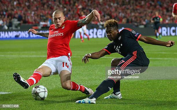 Victor Lindelof of Benfica challenges David Alaba of Bayern Muenchen during the UEFA Champions League quarter final second leg match between SL...