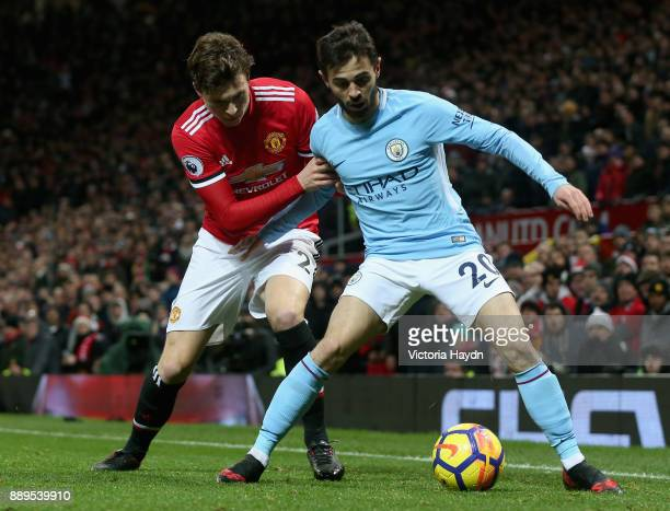 Victor Lindelof of Manchester United and Bernardo Silva of Manchester City in action during the Premier League match between Manchester United and...