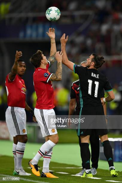 Victor Lindelof of Manchester United and Gareth Bale of Real Madrid argue over the ball during the UEFA Super Cup final between Real Madrid and...