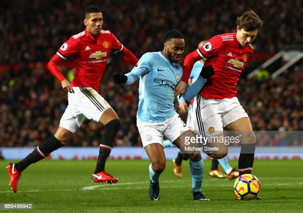 Victor Lindelof of Manchester United and Raheem Sterling of Manchester City battle for the ball during the Premier League match between Manchester...