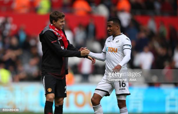 Victor Lindelof of Manchester United greets Martin Olsson of Swansea City after the Premier League match between Swansea City and Manchester United...