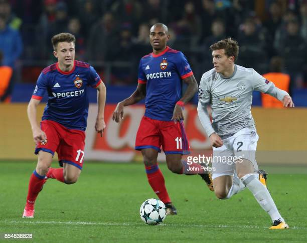 Victor Lindelof of Manchester United in action with Aleksandr Golovin of CSKA Moscow during the UEFA Champions League group A match between CSKA...
