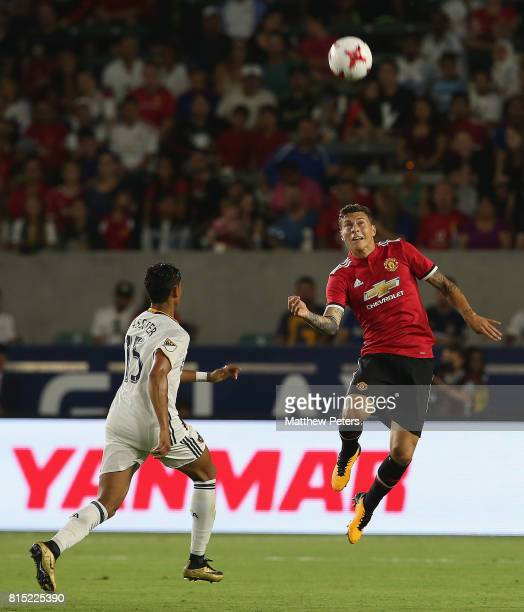 Victor Lindelof of Manchester United in action with Ariel Lassiter of LA Galaxy during the preseason friendly match between LA Galaxy and Manchester...