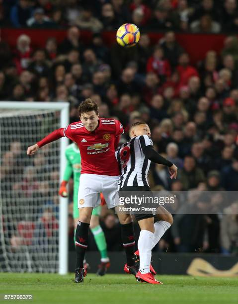 Victor Lindelof of Manchester United in action with Dwight Gayle of Newcastle United during the Premier League match between Manchester United and...
