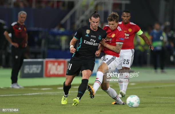 Victor Lindelof of Manchester United in action with Gareth Bale of Real Madrid during the UEFA Super Cup match between Real Madrid and Manchester...