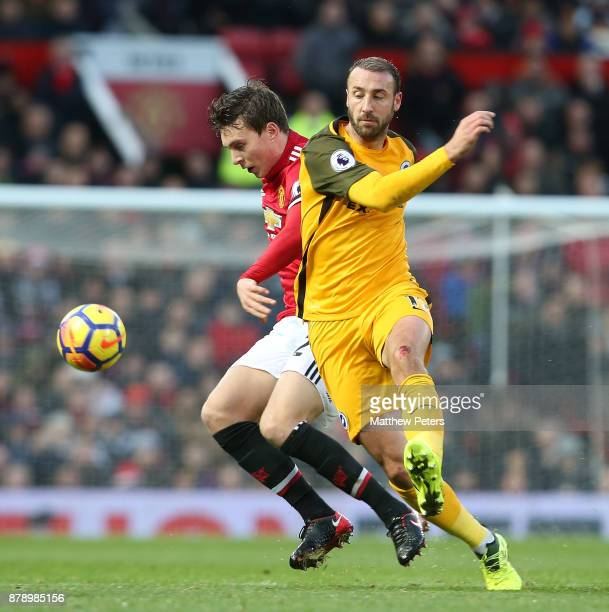 Victor Lindelof of Manchester United in action with Glenn Murray of Brighton and Hove Albion during the Premier League match between Manchester...