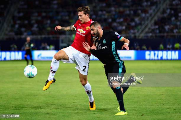 Victor Lindelof of Manchester United is challenged by Karim Benzema of Real Madrid during the UEFA Super Cup match between Real Madrid and Manchester...