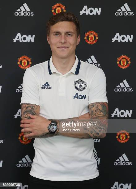 Victor Lindelof of Manchester United poses after signing for the club at Aon Training Complex on June 14 2017 in Manchester England