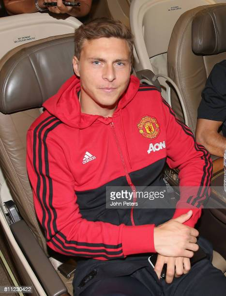 Victor Lindelof of Manchester United sits on the aeroplane ahead of the club's preseason tour of the USA at Manchester Airport on July 9 2017 in...